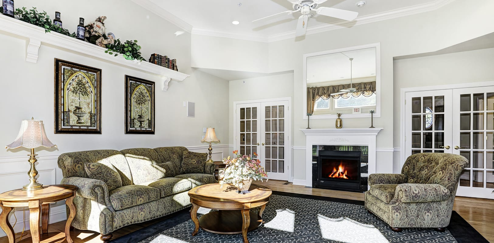 Lounge seating in front of the fireplace in the clubhouse at Hanover Glen in Bethlehem, Pennsylvania