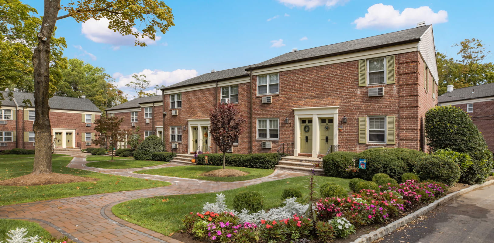 Historical looking brick buildings at General Wayne Townhomes and Ridgedale Gardens in Madison, New Jersey