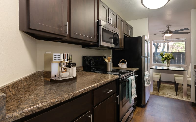 Renovated kitchen with espresso cabinets at Latitude Apartments in Everett, Washington
