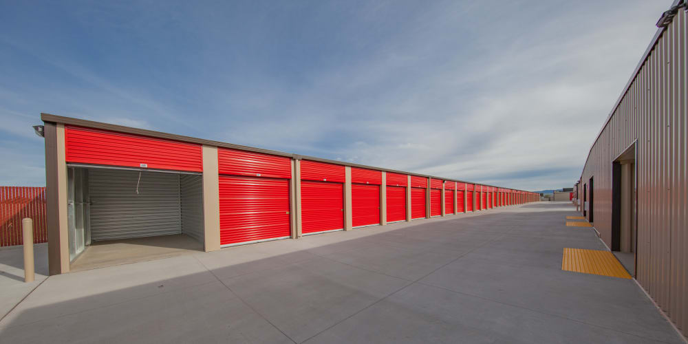 Outdoor storage units with a wide driveway at StorQuest Express Self Service Storage in Phoenix, Arizona