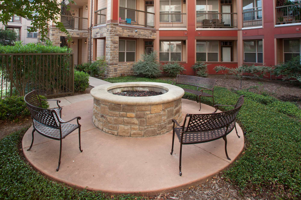 Fire pit area in the courtyard at Olympus Katy Ranch in Katy, Texas