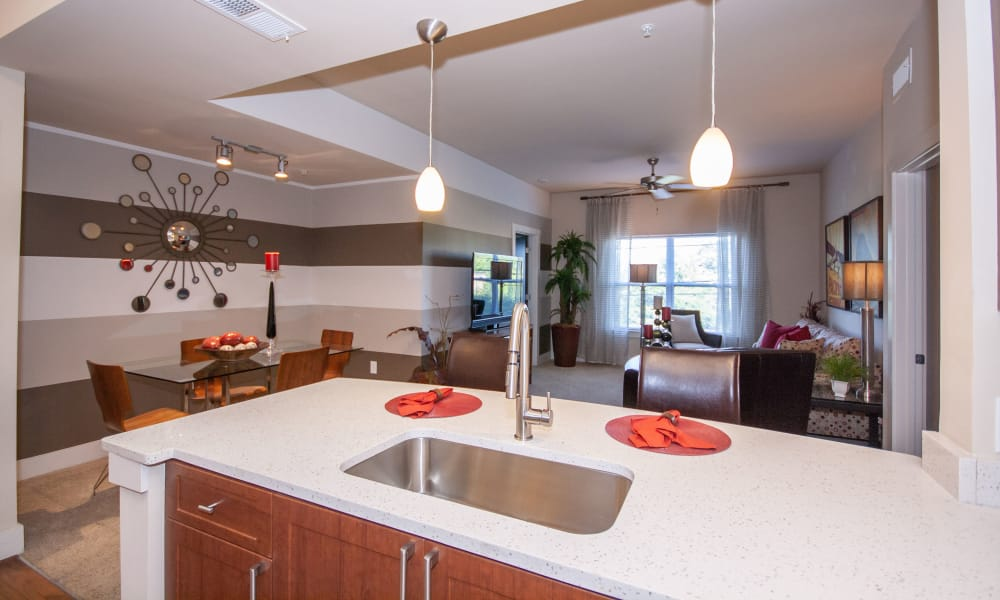 Apartment kitchen and living room at The Atlantic Aerotropolis in Hapeville, Georgia