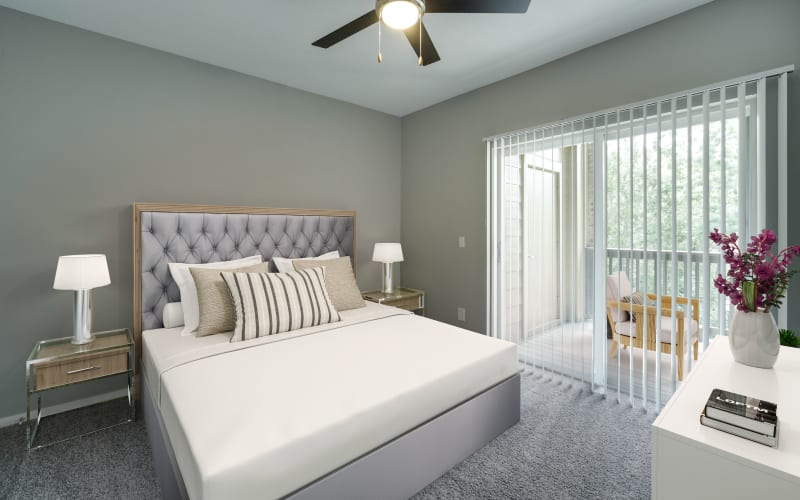 Spacious master bedroom with plush carpeting at The Grove at Orenco Station in Hillsboro, Oregon