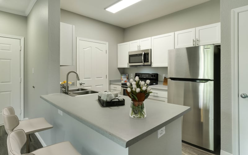 Renovated kitchen with white cabinets at The Grove at Orenco Station in Hillsboro, Oregon