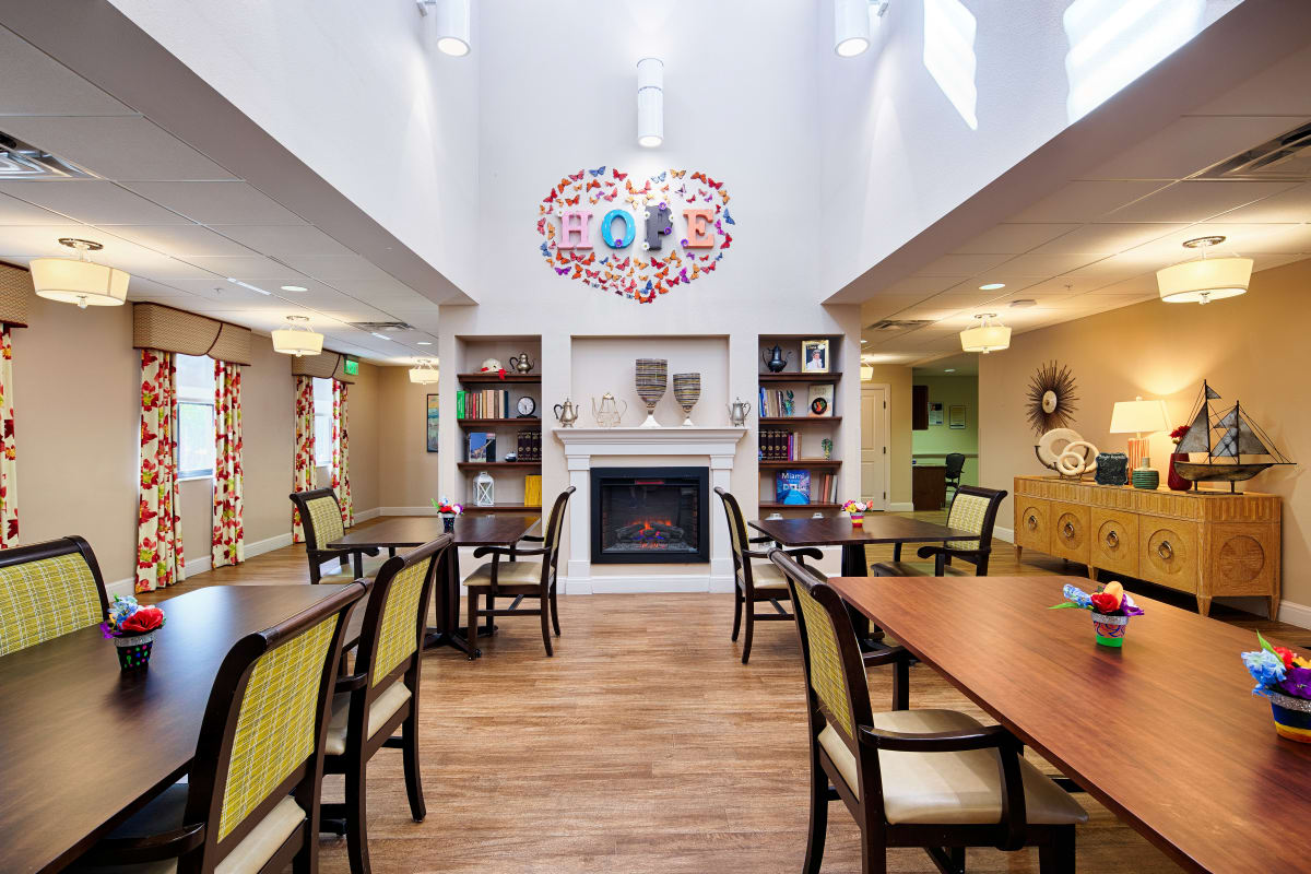 The interior lobby with a fireplace at The Fountains of Hope in Sarasota, Florida.