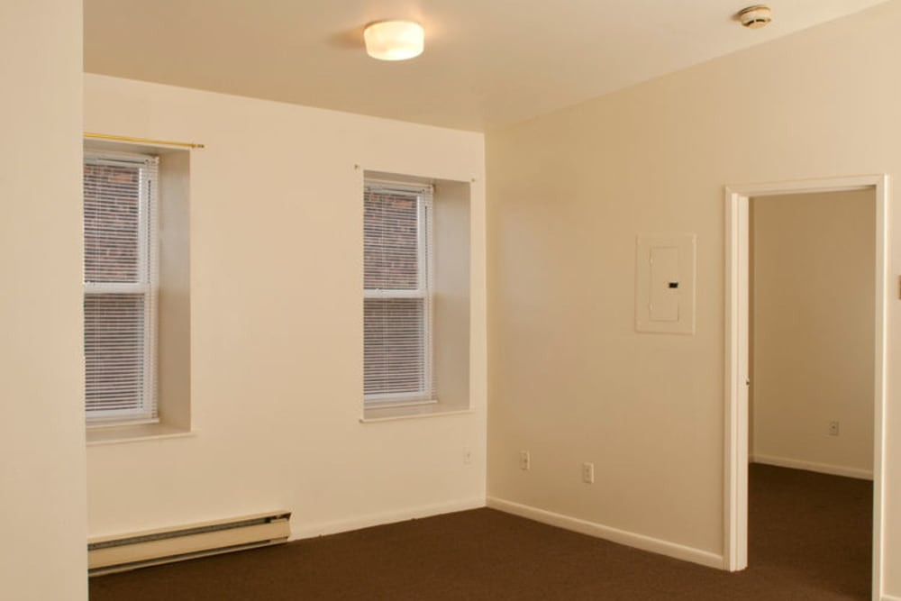 Room with window blinds at Gregory Plaza in Passaic, New Jersey