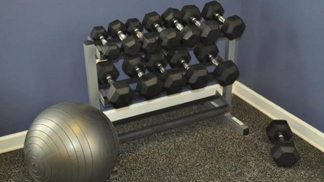 Free weights at the fitness center at Pavilion at Plantation Way