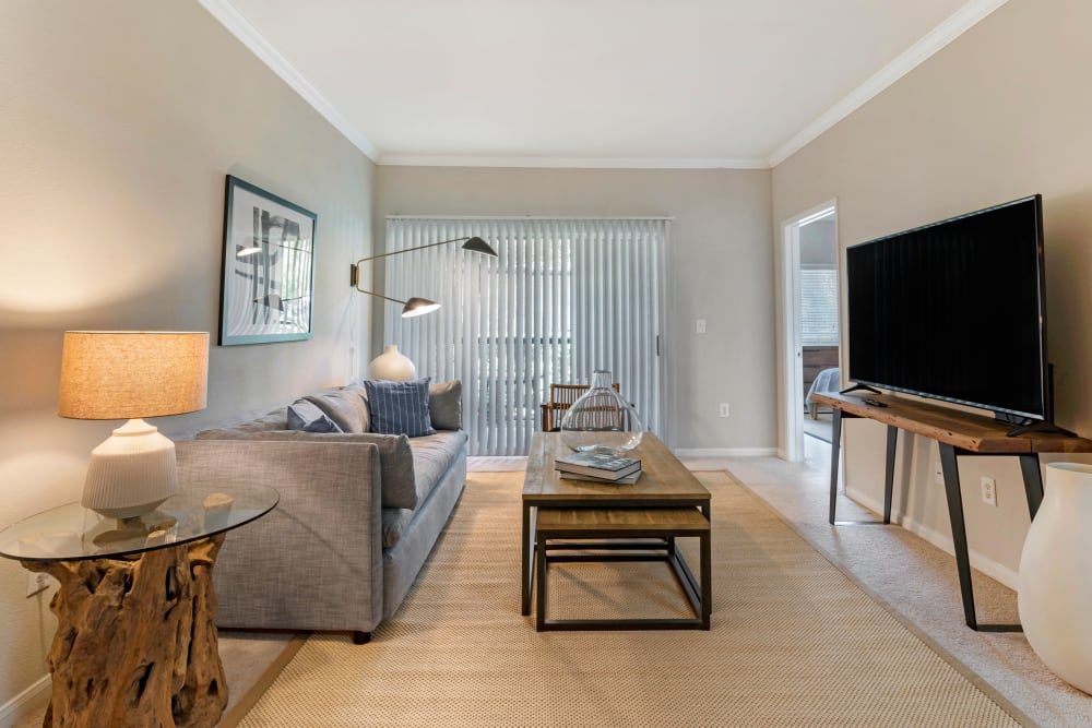Spacious model living room with private balcony access at Regency at First Colony in Sugar Land, Texas