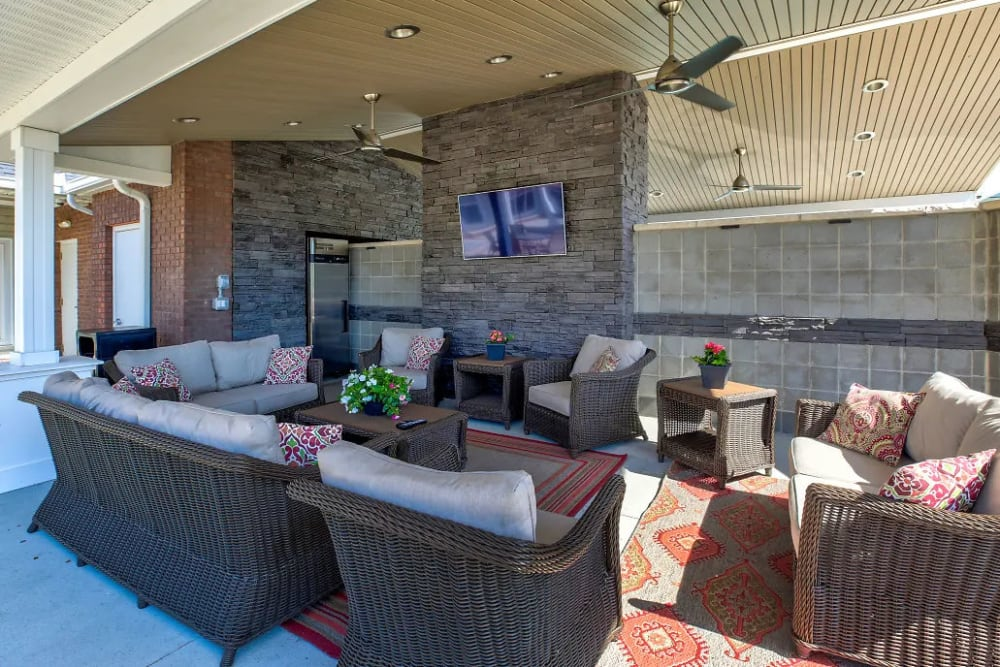 Covered seating area and an outdoor tv at Charleston Pines Apartment Homes in Florence, Kentucky