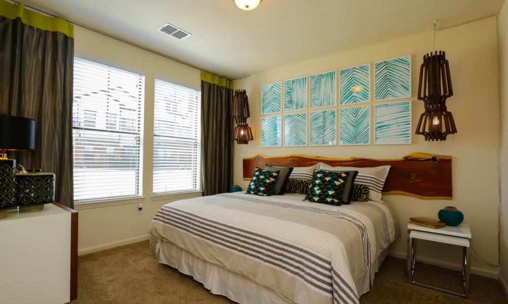 Well-furnished master bedroom in a model home at The Hawthorne in Jacksonville, Florida