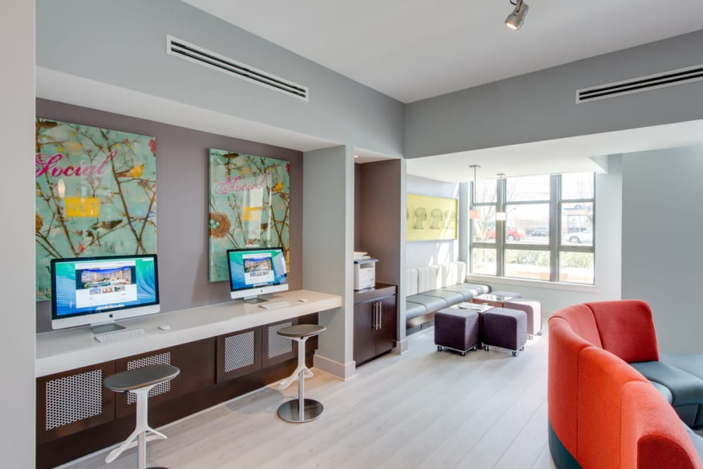 Modern clubhouse lounge with computer stations at Solaire 10914 Georgia in Silver Spring, Maryland