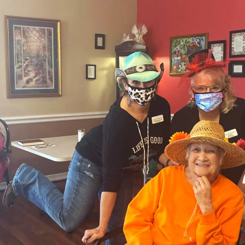 Two masked caretakers with a resident at Canoe Brook Assisted Living in Duncan, Oklahoma