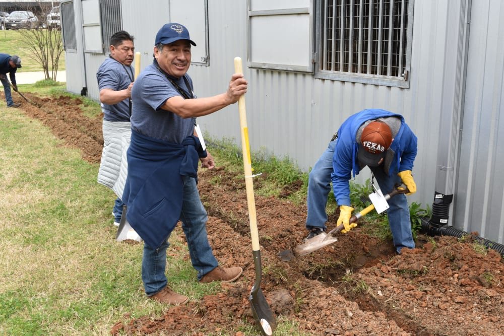Team members digging at a property owned by CWS Apartment Homes in Austin, Texas