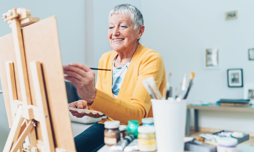 Resident painting in a studio at a Randall Residence community