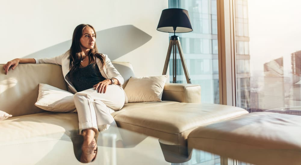 Resident relaxing in her luxury apartment by Electra America in Lake Park, Florida