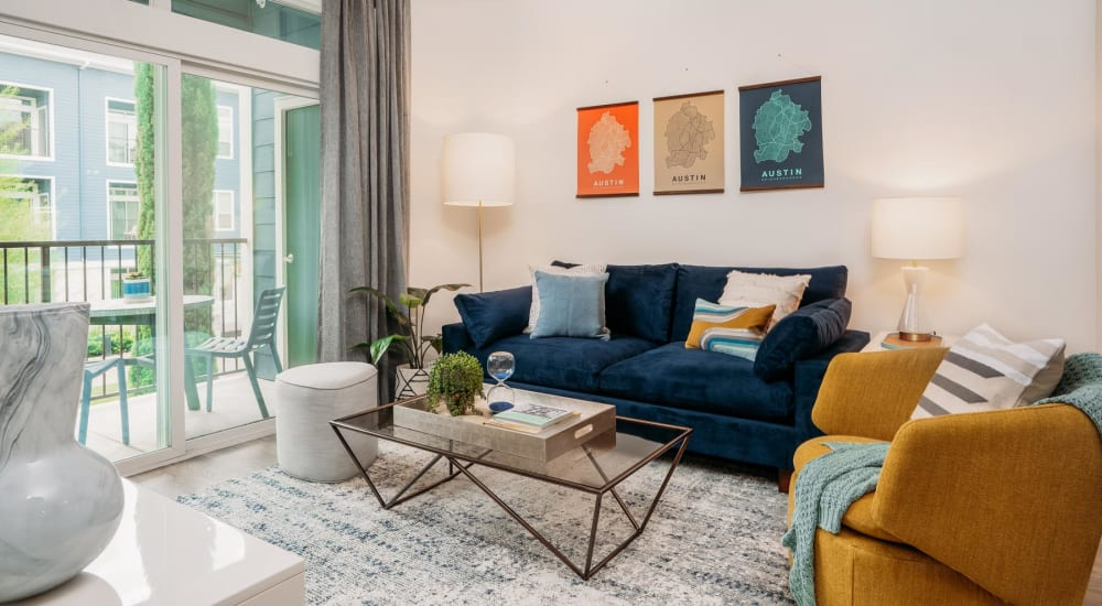 Ceiling fan and modern furnishings in a model home's living area at Lakeshore Pearl in Austin, Texas