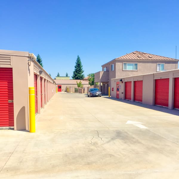 Outdoor storage units with red doors at StorQuest Express - Self Service Storage in Sacramento, California