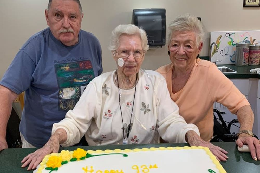 A resident with a cake for her birthday at Forest Oaks of Spring Hill in Spring Hill, Florida