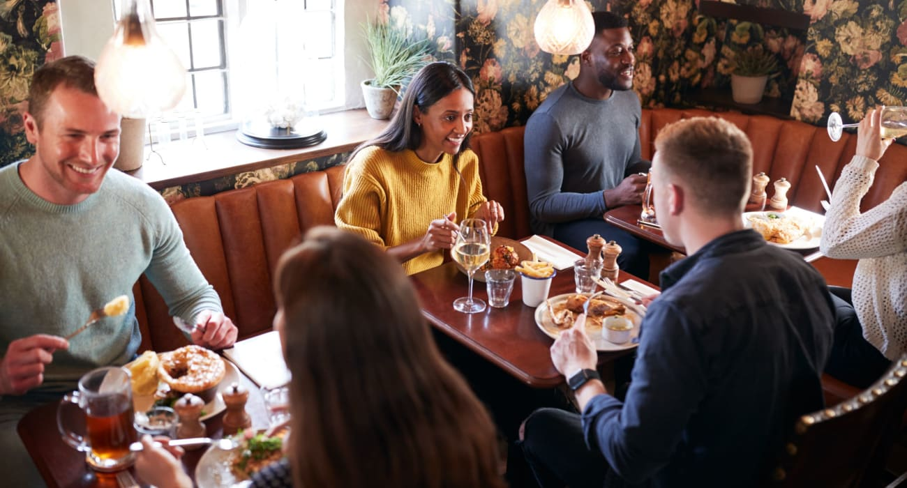 Friends exploring lunch together at a local restaurant in Ridgewood, New Jersey near Mayflower Apartments
