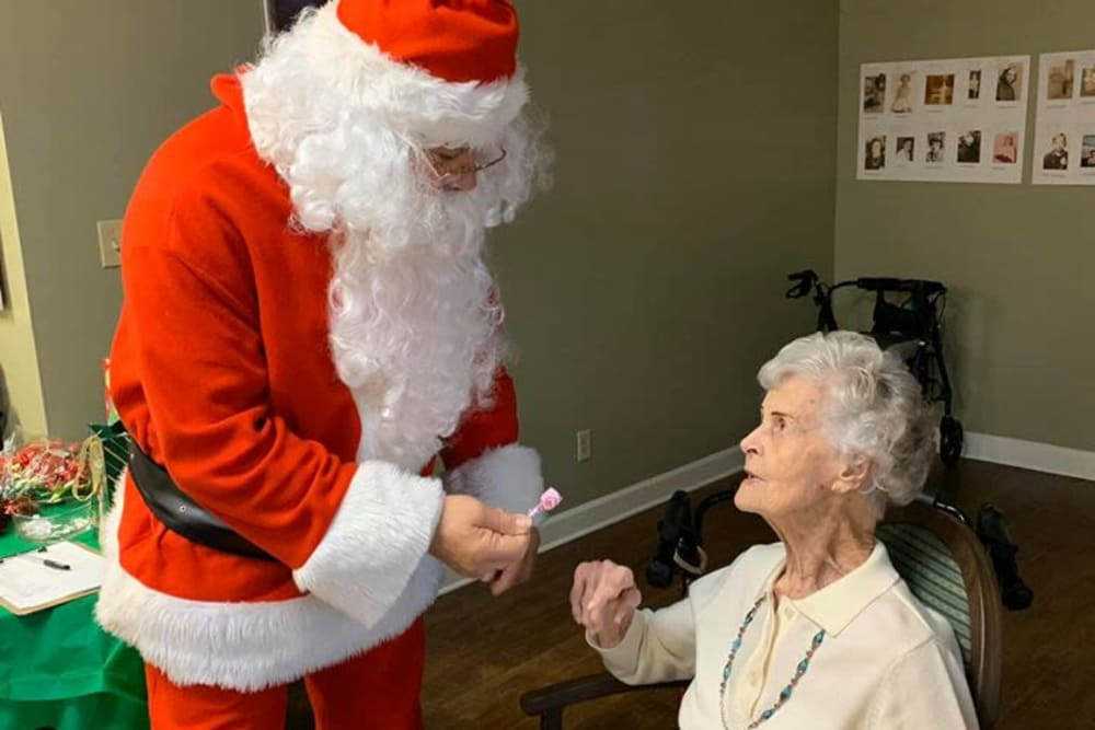 A resident and Santa at Lake Morton Plaza in Lakeland, Florida