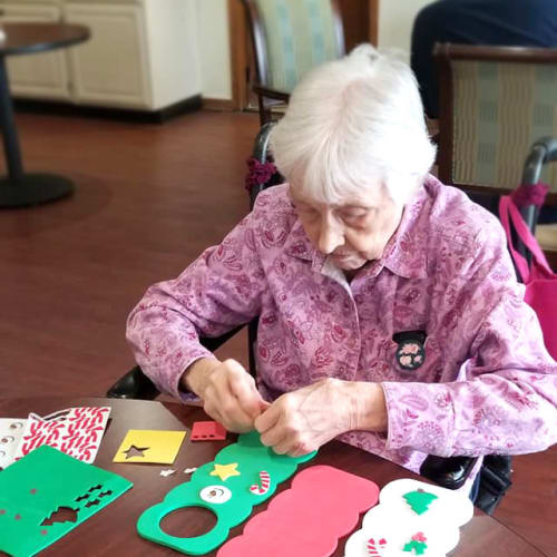 A resident making door hangers at Creekside Village in Ponca City, Oklahoma