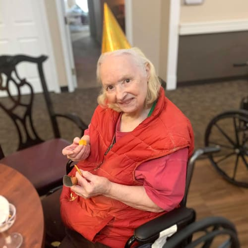 A resident with a gold party-hat on at Canoe Brook Assisted Living in Broken Arrow, Oklahoma