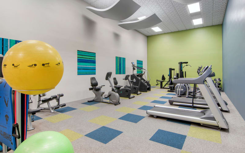 The fully equipped fitness center with cardio machines at Autumn Chase Apartments in Vancouver, Washington