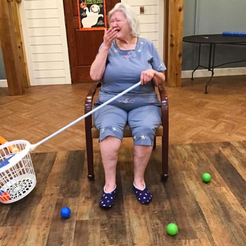 Resident playing a game at Oxford Glen Memory Care at Owasso in Owasso, Oklahoma