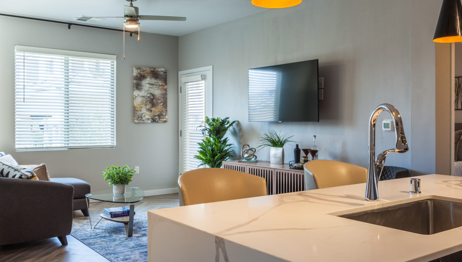 Well-furnished living room with ceiling fan at Olympus Alameda in Albuquerque, New Mexico