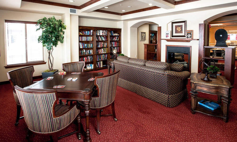 Fireside lounge with comfortable seating at Cedarview Gracious Retirement Living in Woodstock, Ontario