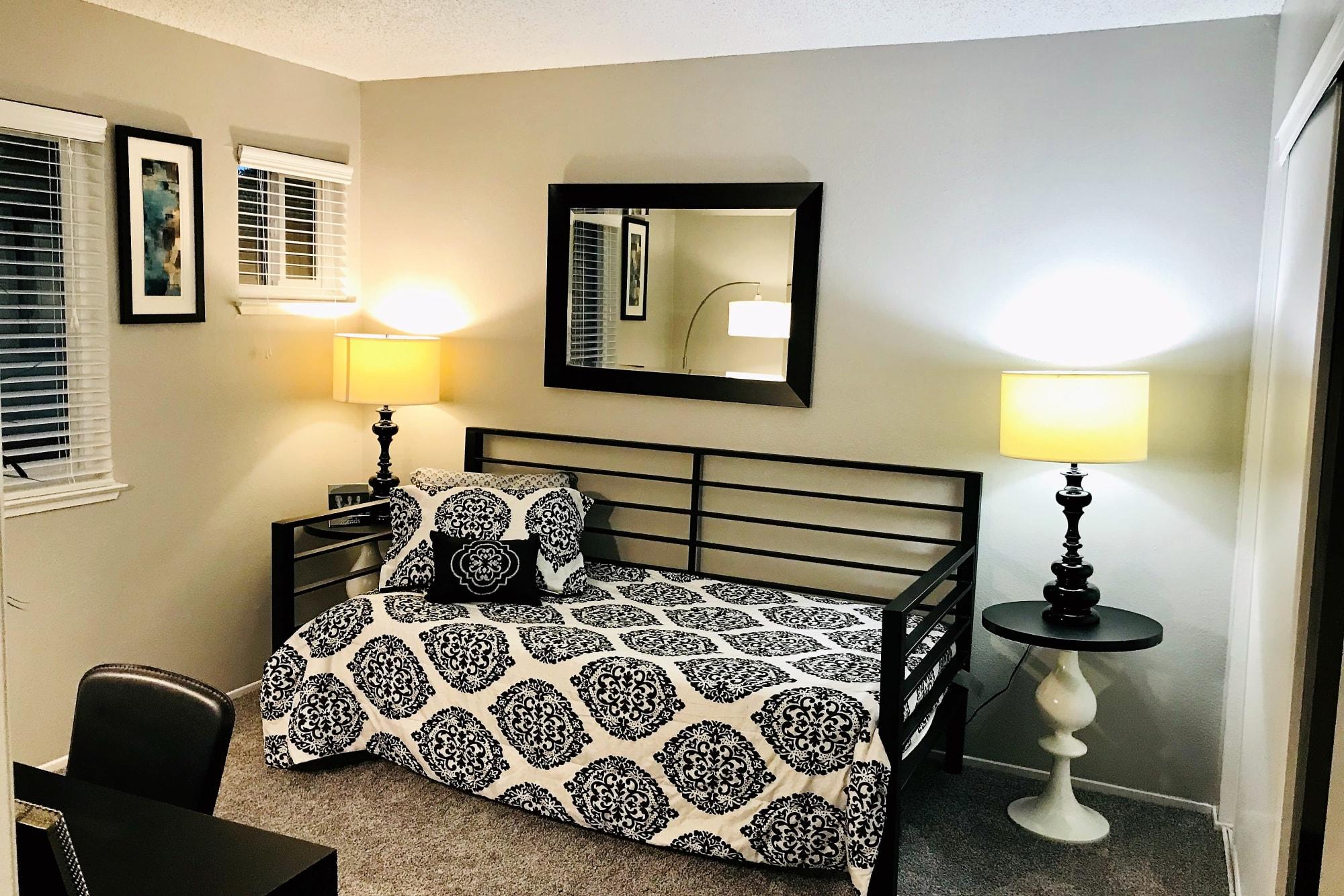 A comfy master bedroom at Bennington Apartments
