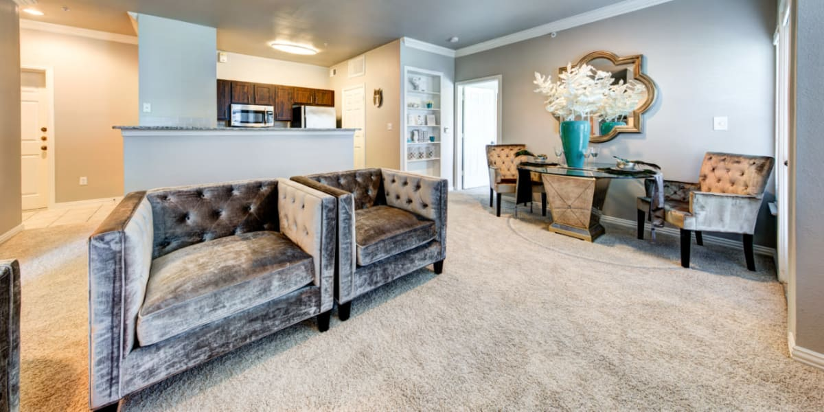 Modern style living room with sitting chairs and dining area at Marquis at Silver Oaks in Grapevine, Texas