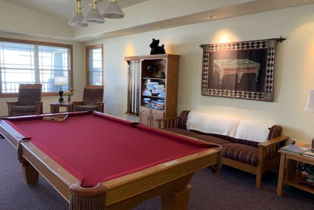 Activity room includes a pool table at Prairie Hills in Clinton, Iowa.