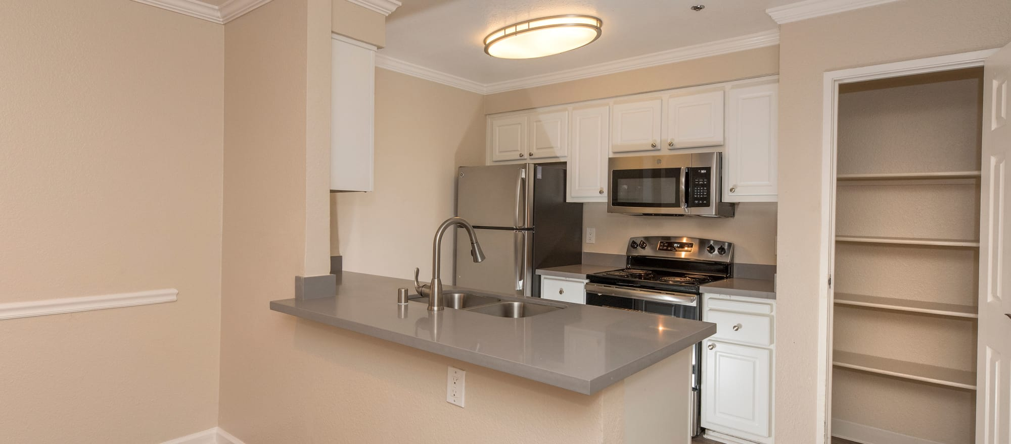 Lovely model kitchen at Sterling Heights Apartment Homes in Benicia, California