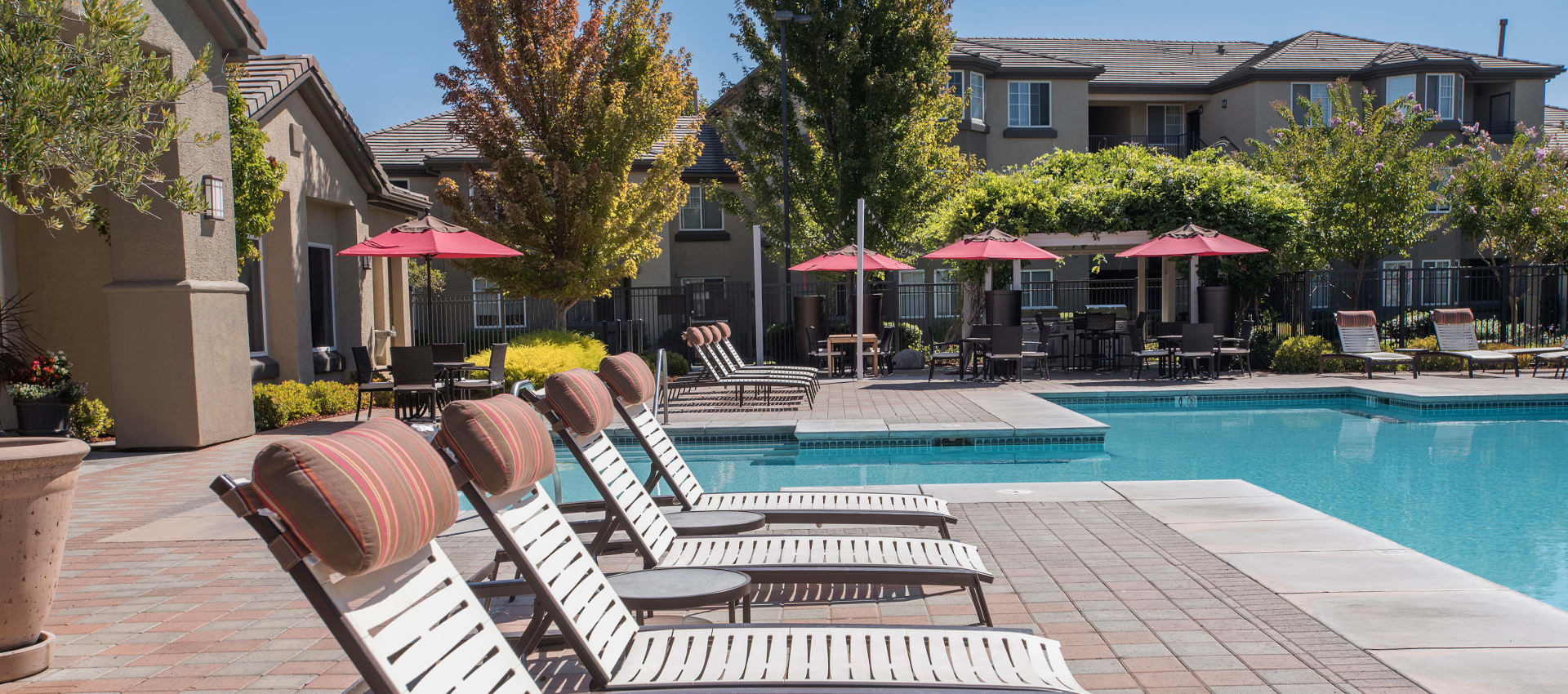 State-of-the-art swimming pool and lounge area at The Artisan Apartment Homes in Sacramento, California