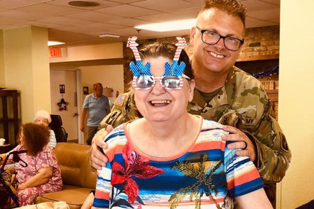 A resident and family member enjoying an event at Bayside Terrace in Pinellas Park, Florida