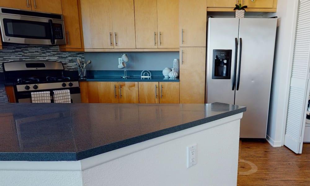 Spacious kitchen in an open-concept three bedroom model home at Esprit Marina del Rey in Marina del Rey, California