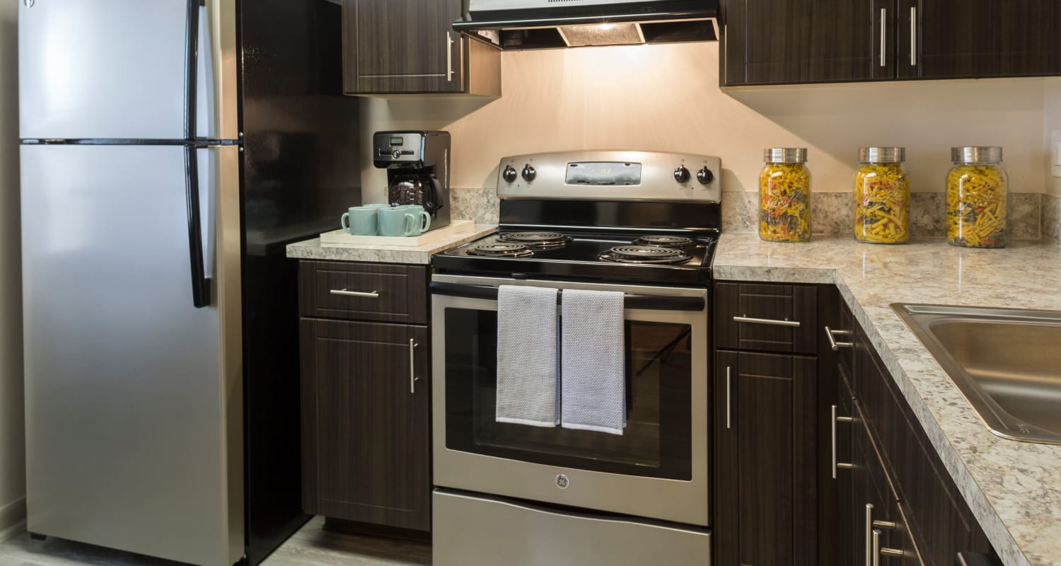 Kitchen with oven and refrigerator at Siena Apartments in Plantation, Florida