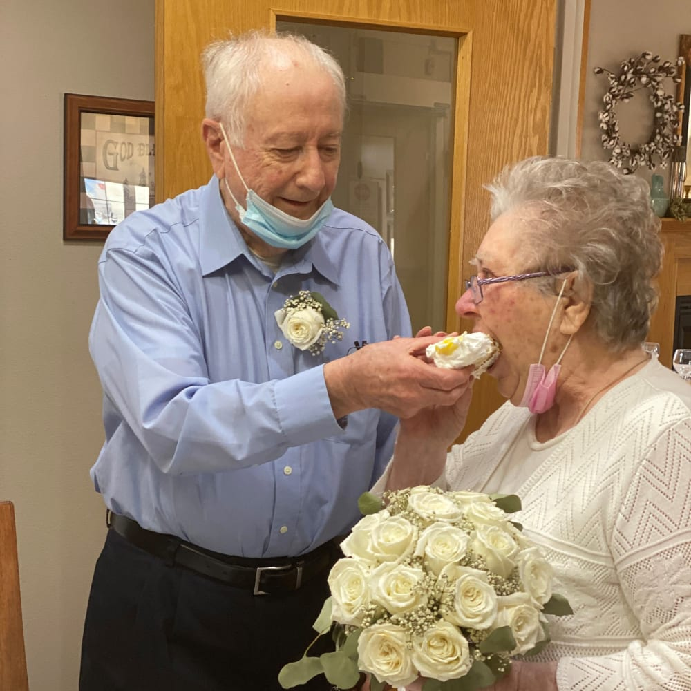 Residents sharing cake at birthday at Glenwood Place in Marshalltown, Iowa.