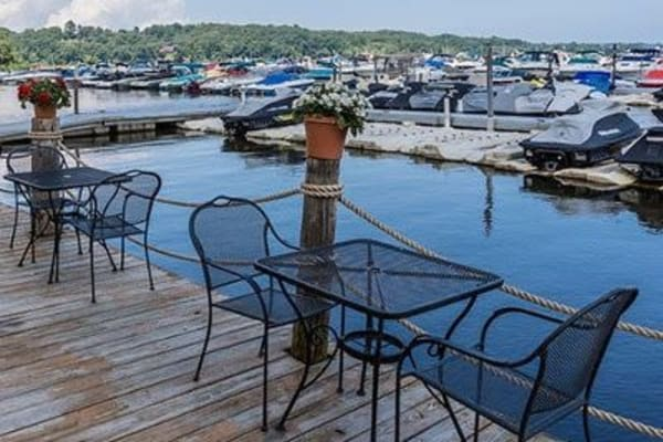 Outdoor patio on a lake in Webster, New York near Oakmonte Apartments