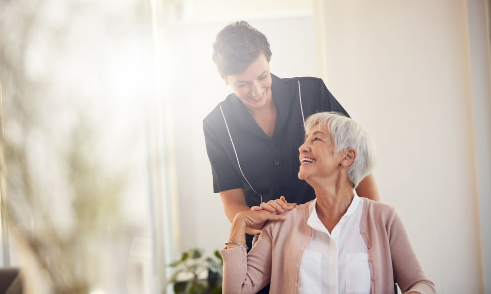 Caregiver chatting with a resident at The Vista in Esquimalt, British Columbia