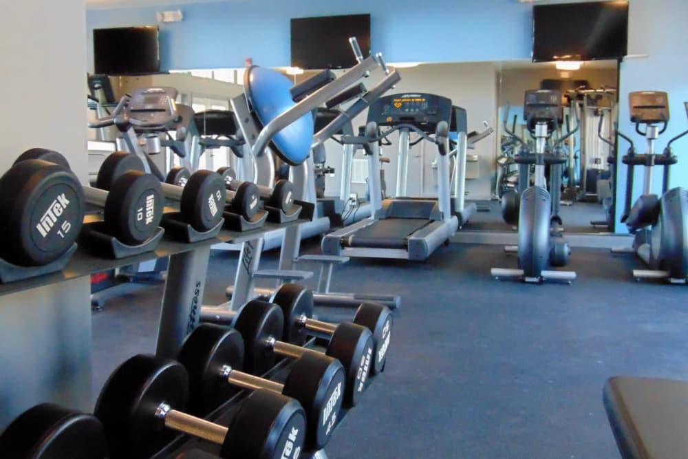 Unique fitness center at Watercourse Apartments in Graham, North Carolina