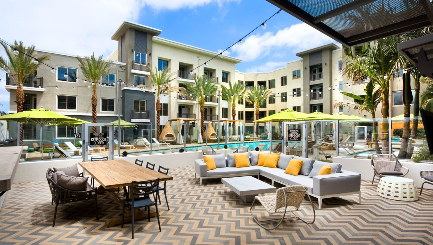 Pool patio for residents at Olympus Corsair in San Diego, California