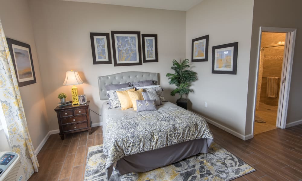 A resident bedroom with private bathroom at Inspired Living Bonita Springs in Bonita Springs, Florida