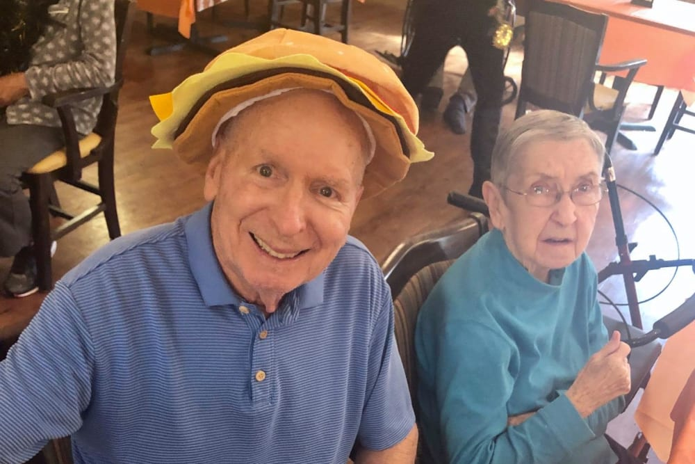 A happy resident with a silly hat on at Magnolias of Chesterfield in Chester, Virginia