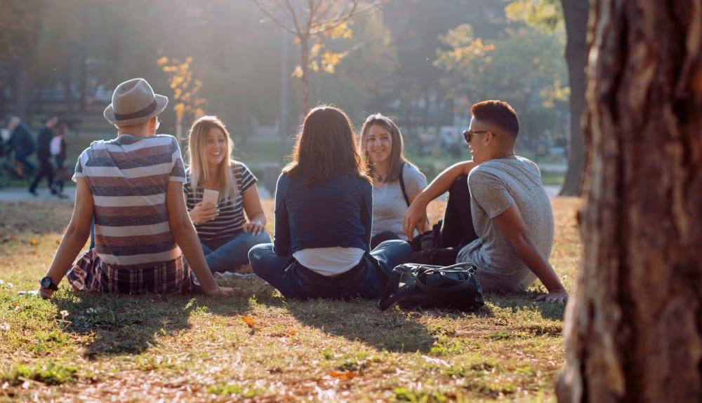 Residents enjoying a picnic together near UNCOMMON Tuscaloosa in Tuscaloosa, Alabama