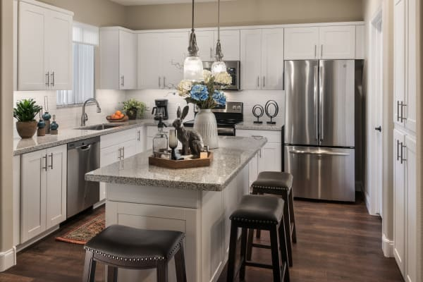 Gourmet kitchen with granite countertops and stainless-steel appliances at San Villante in Mesa, Arizona