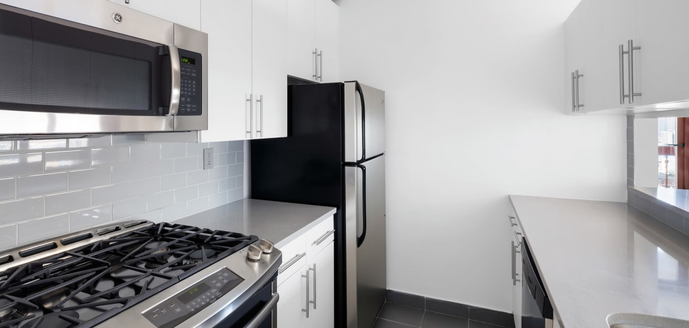 Kitchen with stainless-steel appliances at The Ellington in New York, New York
