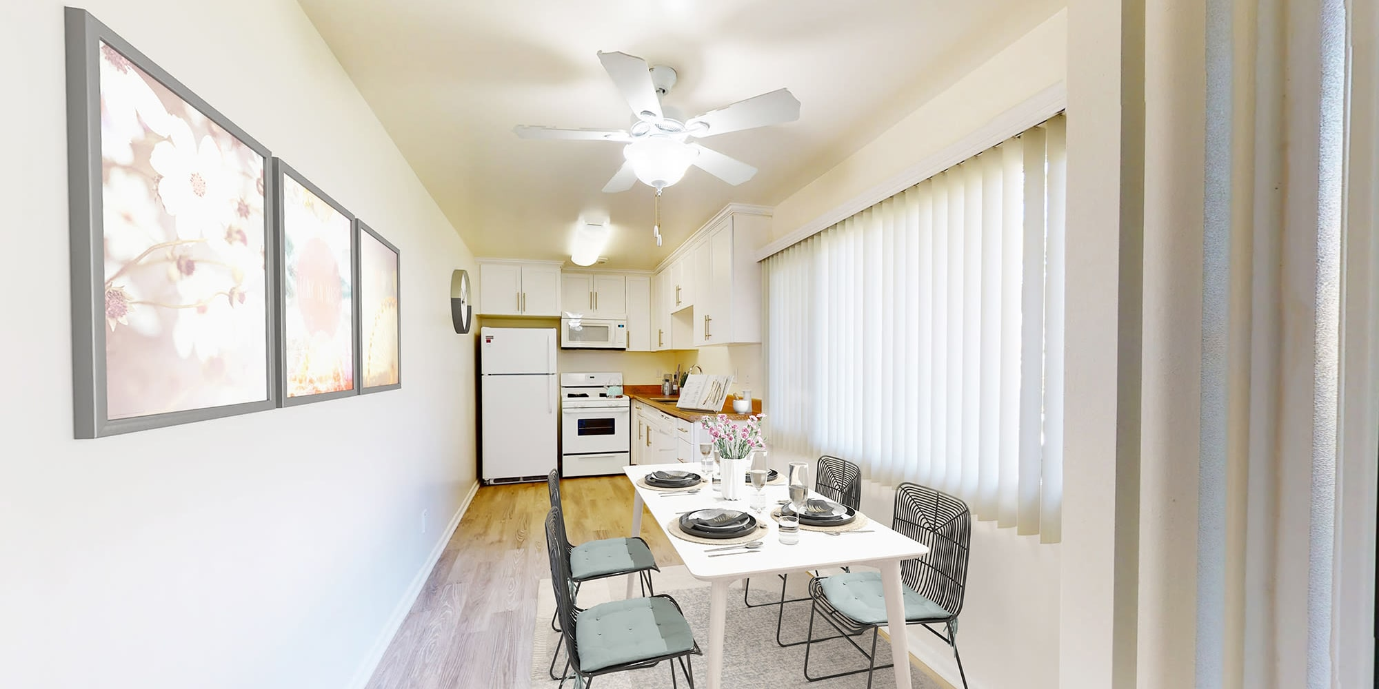 View of the kitchen from the dining area of a model two bedroom home at West Park Village in Los Angeles, California