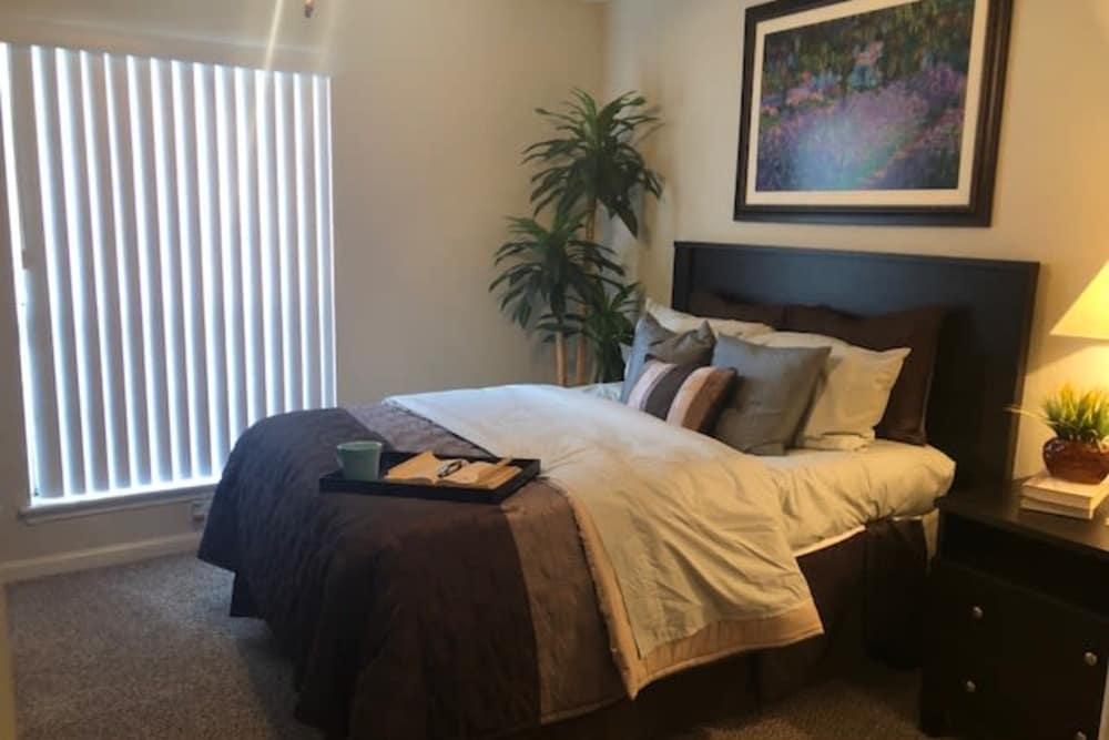Cozy bedroom at The Reserve at City Center North in Houston, Texas